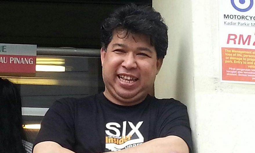 Mr Jahabar Sadiq, chief executive of The Malaysian Insider (TMI) news portal, seen in this picture shortly after he was released on police bail on Wednesday, April 1, 2015. He was arrested for sedition on March 31 along with Mr Ho Kay Tat, publisher