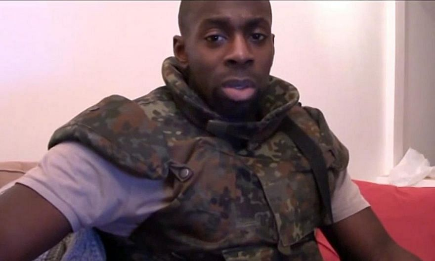 Three men arrested as part of an investigation into the Paris attacks in January in which 17 people were killed are linked to Amedy Coulibaly (above), one of the three Islamist militant gunmen who perpetrated the attacks, the Paris prosecut