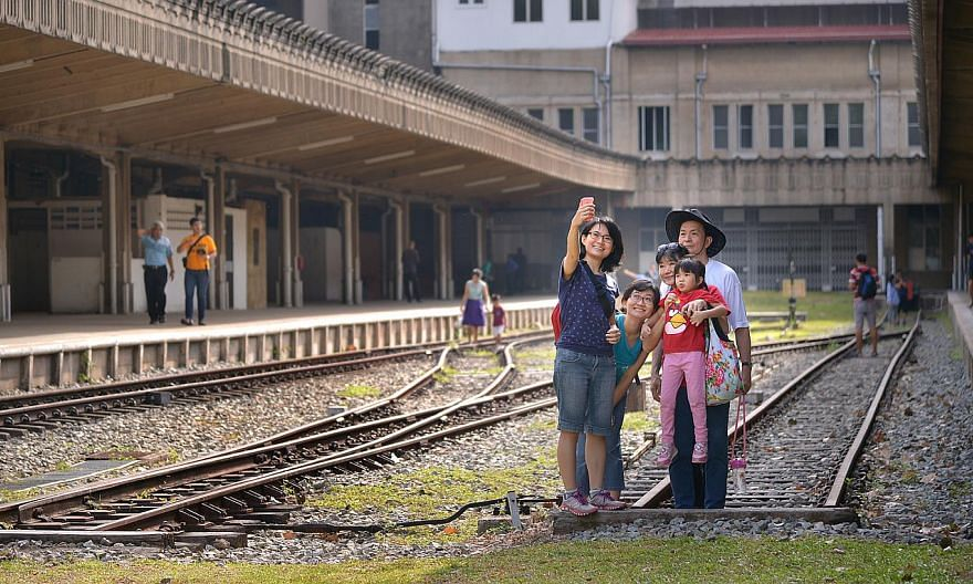 Visitors taking a picture of themselves at the former Tanjong Pagar Railway Station. It will open its doors to the public on Good Friday from 9am to 6pm. -- ST PHOTO: LIM SIN THAI
