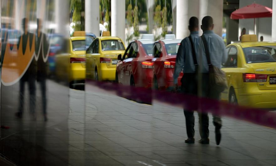 Once changes are approved, all 28,000 cabs on the road will have to charge the same peak-period, location, city, and midnight surcharge rates. -- ST PHOTO: KUA CHEE SIONG