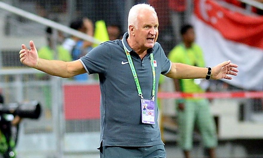 Singapore coach Bernd Stange urging his players during the Group B match of the AFF Suzuki Cup between Singapore and Maynmar held at the National Stadium at the Singapore Sports Hub on Nov 26, 2014. -- PHOTO: BH FILE