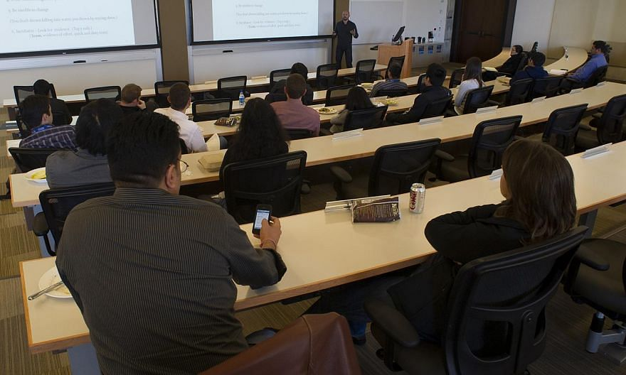 Students at a University of Pennsylvania's Wharton School lecture in San Francisco. Even if scholars agree on the importance of publishing in the popular media, the system plays against them. Publications in peer-reviewed journals continue to be the