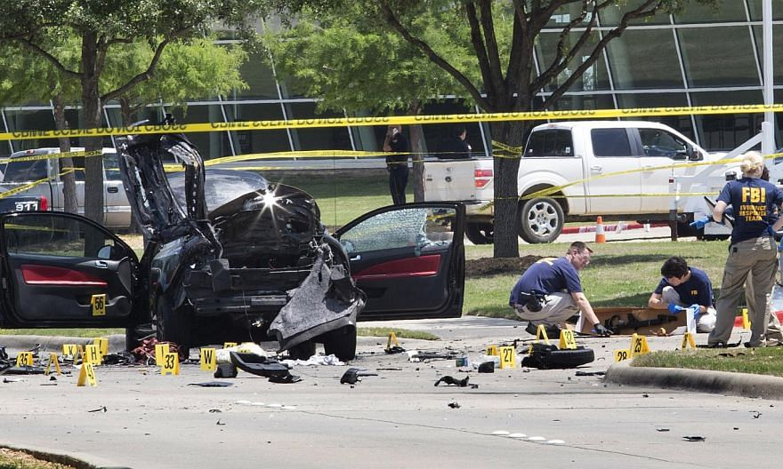 Local police and FBI investigators collect evidence where two gunmen, who opened fire on Sunday outside an exhibit of caricatures of the Prophet Muhammad, were shot dead in Garland, Texas on May 4, 2015. -- PHOTO: REUTERS