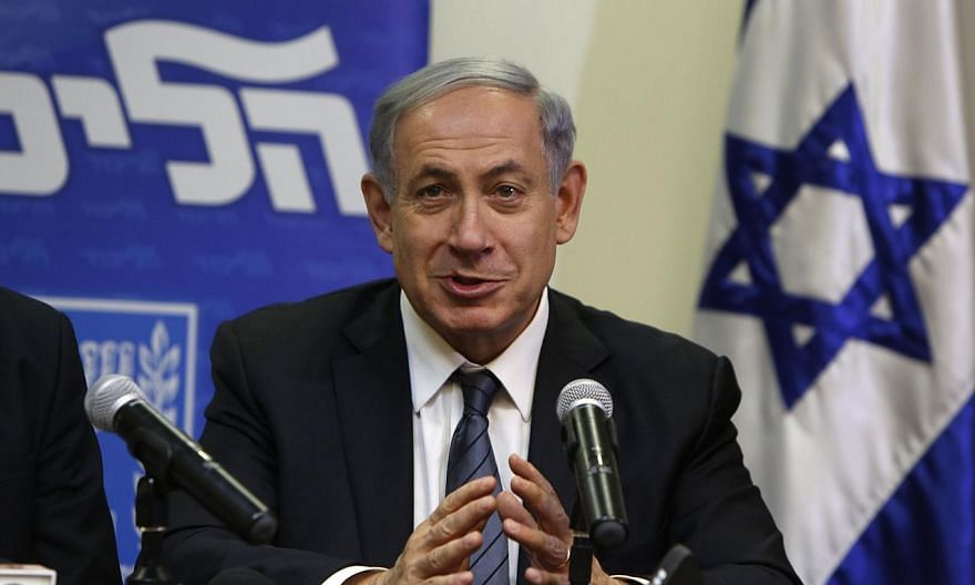 Israeli Prime Minister Benjamin Netanyahu speaks during a press conference at the Knesset in Jerusalem late on Wednesday to announce the formation of a coalition government and reaching an agreement with the religious nationalist Jewish Home party. -