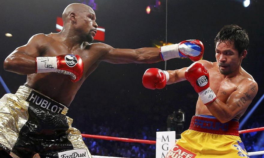 """Floyd Mayweather Jr (left) and Manny Pacquiao during the fifth round of their fight in Las Vegas on May 2, 2015. Two days after saying he would be open to a re-match with Pacquiao, Mayweather reversed course on Thursday, describing the Filipino as """"a"""