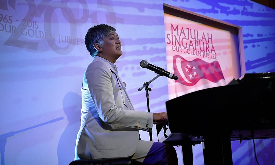 Composer Dick Lee performing this year's Golden Jubilee National Day song Our SIngapore when he unveiled it two days ago. -- ST PHOTO: KUA CHEE SIONG