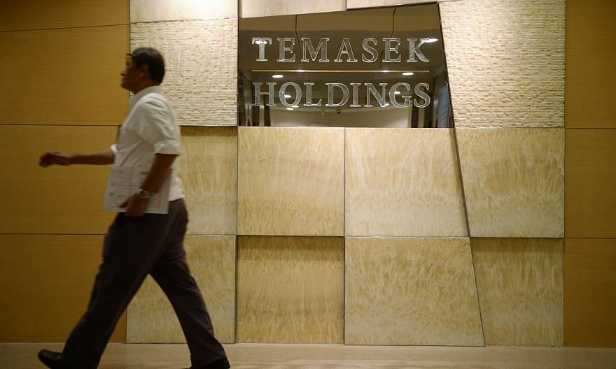 A man walks pass the Temasek Holdings office on Feb 16, 2015. A constitutional change was sought on Monday to make Temasek Holdings a bigger contributor to the Government's coffers, as Singapore prepares for moresocial and infrastructure spendi
