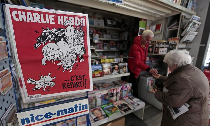 The front page of the new issue of satirical French weekly Charlie Hebdo entitled C'est Reparti (Here we go again), is displayed at a kiosk in Nice on Feb 25, 2015. -- PHOTO: REUTERS