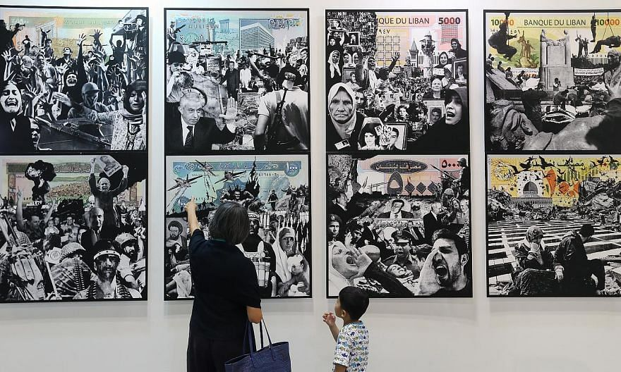 """Visitors at the Singapore Art Fair at the Suntec Singapore Convention & Exhibition Centre in 2014. A year after its first outing, the fair has """"postponed"""" its 2015 edition. -- PHOTO: ST FILE"""