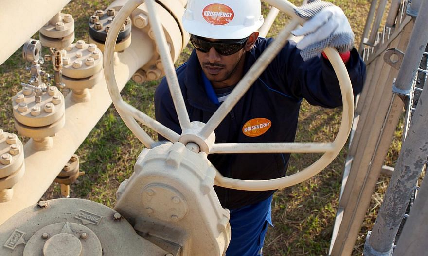 A worker at a KrisEnergy site. The mainboard-listed firm announced on Thursday that net profit for the first quarter ended March 31, 2015, jumped to US$46.3 million (S$61.32 million) from a net loss of US$18 million in the year-ago period. -- PHOTO:
