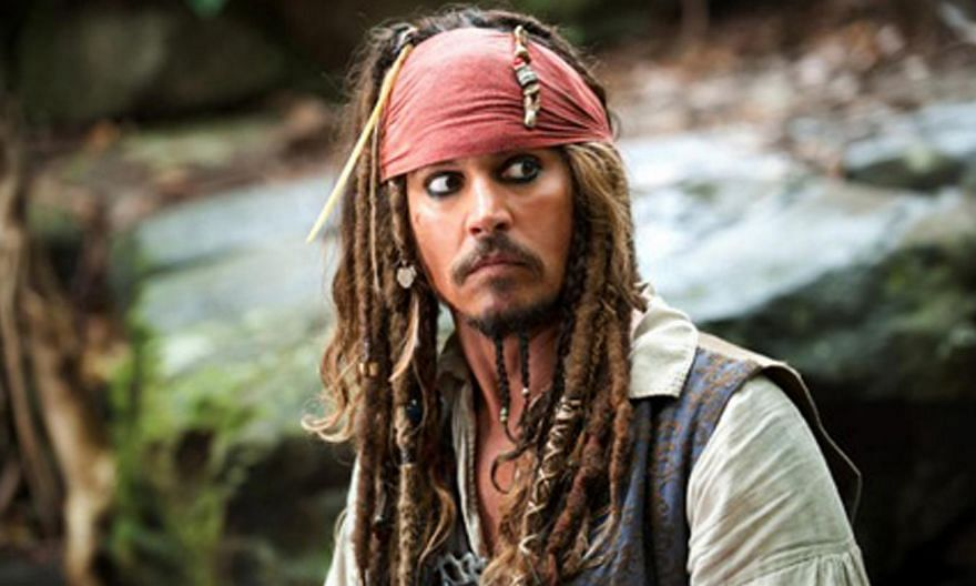"""Johnny Depp's pet dogs Pistol and Boo face being put down unless they """"bugger off"""" back to Hollywood after he brought them into Australia illegally on his private jet. -- PHOTO:SINGTEL"""