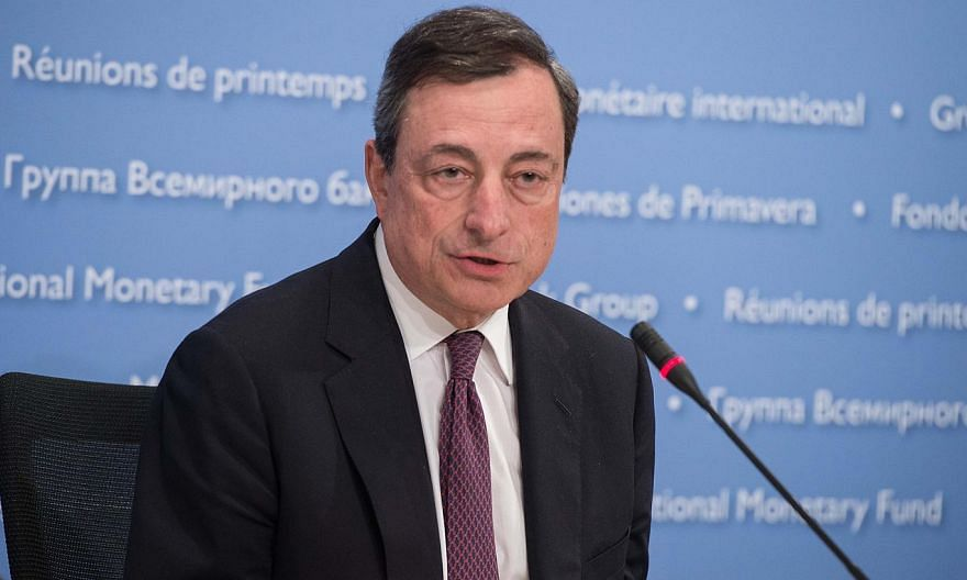 """European Central Bank President Mario Draghi said Thursday that the bank's massive stimulus for the eurozone will remain in force """"as long as needed"""" to stabilize prices. -- PHOTO: AFP"""