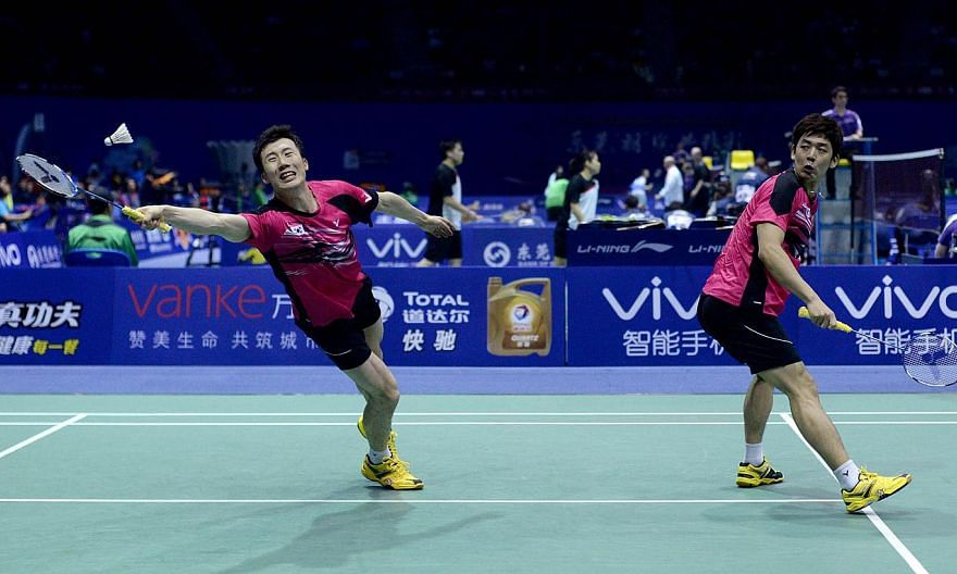 South Korea's Lee Yong Dae (left) and Yoo Yeon Seong (right) return to Malaysia's Goh V Shem and Tan Wee Kiong during their men's doubles quarter final match of the 2015 Sudirman Cup world badminton championships in Dongguan, south China's Guangdong