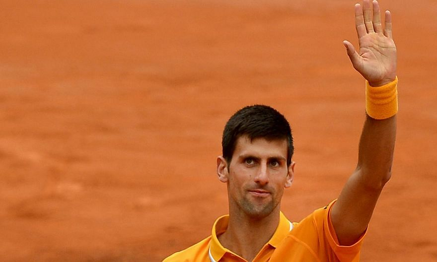 Novak Djokovic of Serbia celebrates after winning against David Ferrer of Spain on May 16, 2015 in Rome. -- PHOTO: AFP