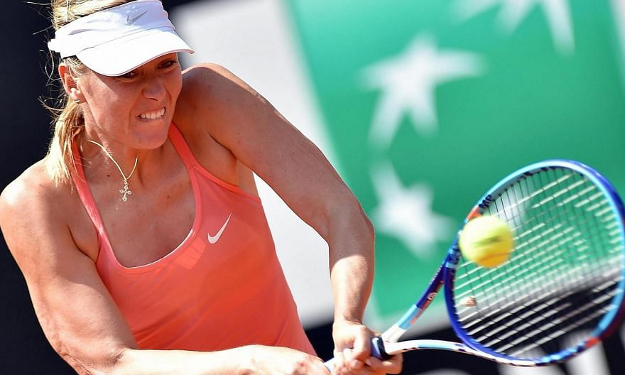 Maria Sharapova of Russia returns the ball to Carla Suarez Navarro of Spain during their final match for the Italian Open tennis tournament at the Foro Italico in Rome on Sunday. -- PHOTO: EPA