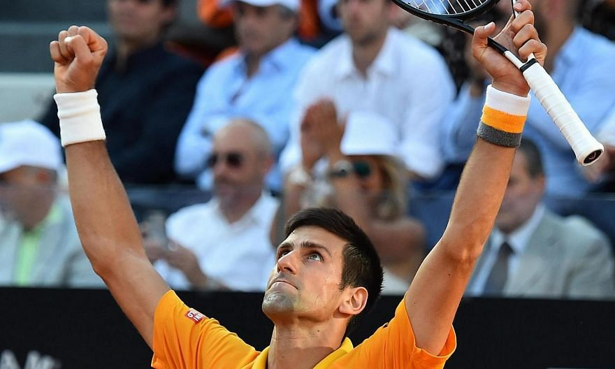 Novak Djokovic of Serbia celebrates after beating Swiss Roger Federer in their final match for the Italian Open tennis tournament at the Foro Italico in Rome on Sunday. -- PHOTO: EPA