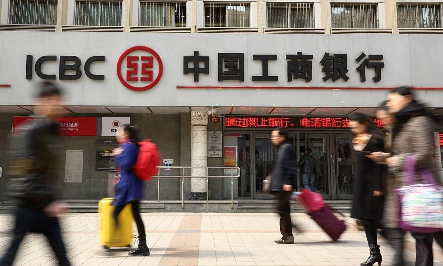 A businesswoman deposited 10.8 million yuan (S$2.3 million) at a branch of China's largest bank, but only 124 yuan (S$26.50) remained after most of it was transferred without her authorisation, state media reported. -- PHOTO: BLOOMBERG