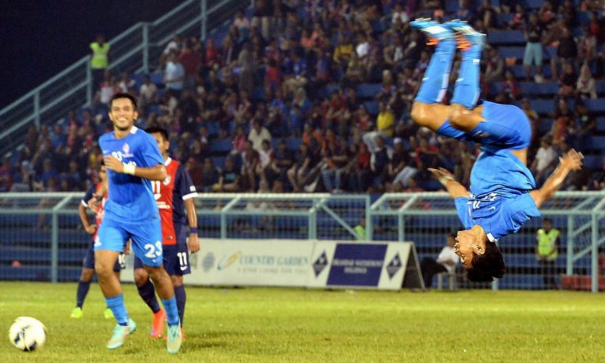 Muhammad Nazrul Nazari celebrates after scoring LionsXII's second goal against Johor Darul Takzim II (JDTII) in the second Leg of the Malaysia FA Cup quarter-final match held at the Corporation Stadium in Pasir Gudang, Johor on April 22, 2015. -- PHO