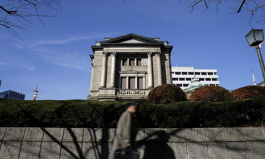 The Bank of Japan maintained its massive monetary stimulus on Friday and offered a slightly more upbeat view of the economy, unfazed by first-quarter GDP data that offered mixed signs on the strength of the recovery. -- PHOTO: BLOOMBERG