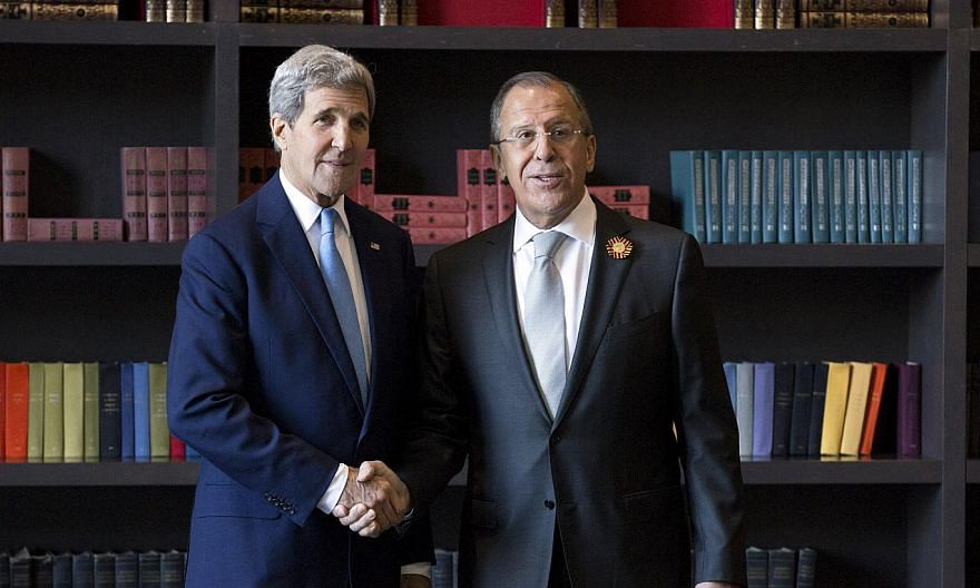 US Secretary of State John Kerry (left) shakes hands with Russian Foreign Secretary Sergei Lavrov before a bilateral meeting in Sochi, Russia May 12, 2015. Russian Foreign Minister Sergei Lavrov discussed the situation in Syria and Yemen as well as U
