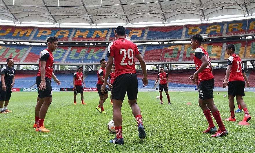 LionsXII coach Fandi Ahmad (left), who has a history of success on Malaysian soil, directing the LionsXII during a training session at Bukit Jalil Stadium yesterday. In 1980, 18-year-old Fandi scored the winner against Selangor and 14 years later, he
