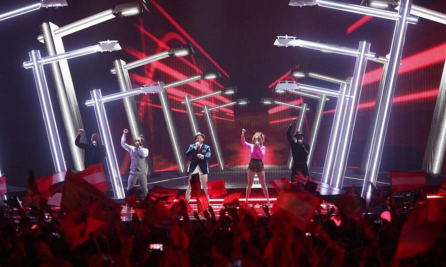 Guy Sebastian (centre) performs during the Grand Final of the 60th annual Eurovision Song Contest (ESC) at the Wiener Stadthalle in Vienna, Austria, on May 23, 2015. -- PHOTO: EPA