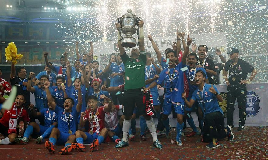 The LionsXII celebrating their Malaysia FA Cup victory after they defeated Kelantan 3-1 at the Bukit Jalil Stadium on Saturday night. -- ST PHOTO: NEO XIAOBIN