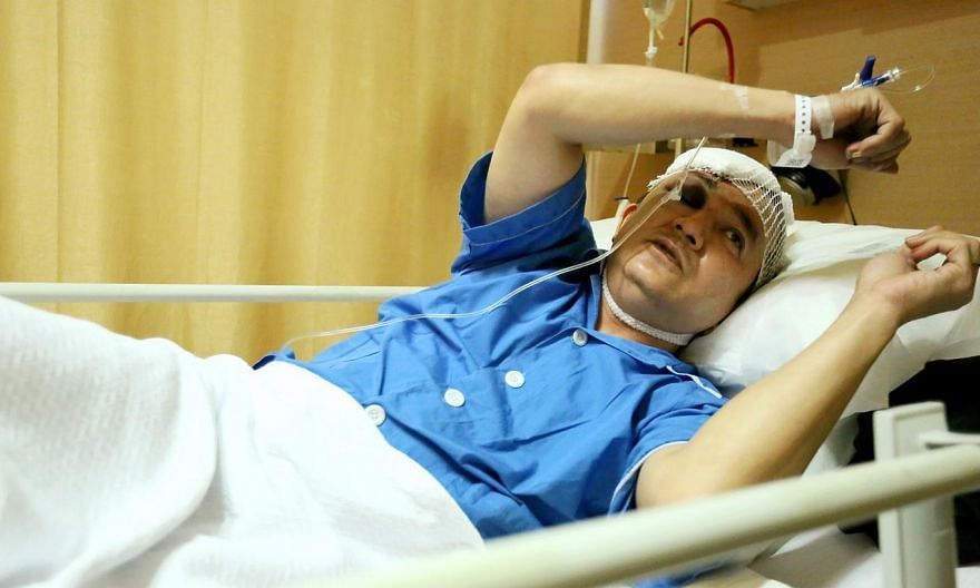 Taxi driver Raymond Lee, 46, had more than 10 stitches for the injury to his head.