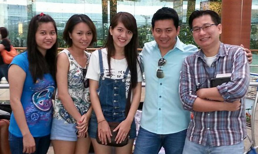 Tourist Pham Van Thoai (second from right), his girlfriend and Mr Gabriel Kang, who raised more than $15,500 online last November. -- PHOTO: GABRIEL KANG