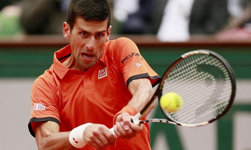 Serbia's Novak Djokovic in action during the first round of the French Open atRoland Garros in Paris. -- PHOTO: REUTERS