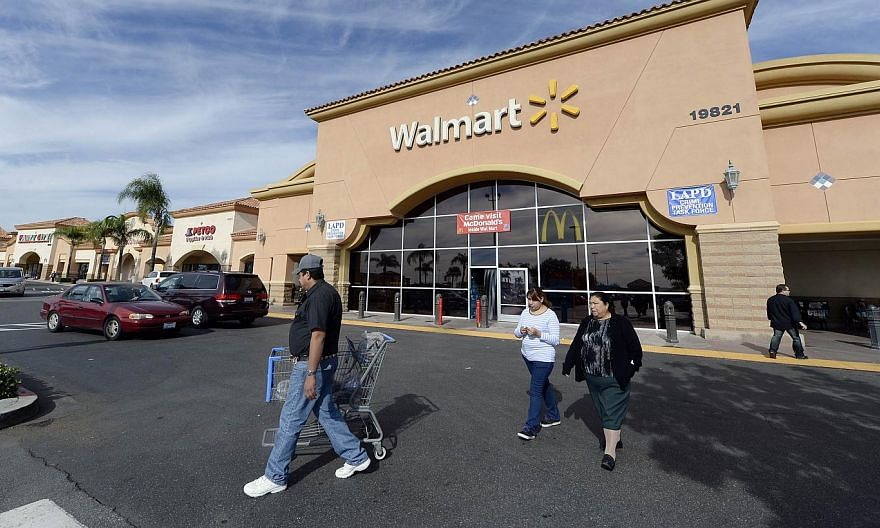 Customers walking outside a Walmart store in the Porter Ranch section of Los Angeles on Nov 26, 2013. -- PHOTO: REUTERS