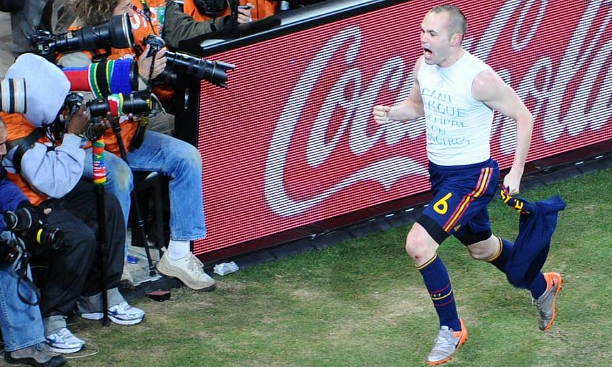 Spain's midfielder Andres Iniesta celebrates after scoring the opening goal during extra-time in the 2010 World Cup football final Netherlands v Spain on July 11, 2010. Adidas, along with Coca-Cola, Hyundai and Kia Motors, Visa, and Russian energy gi