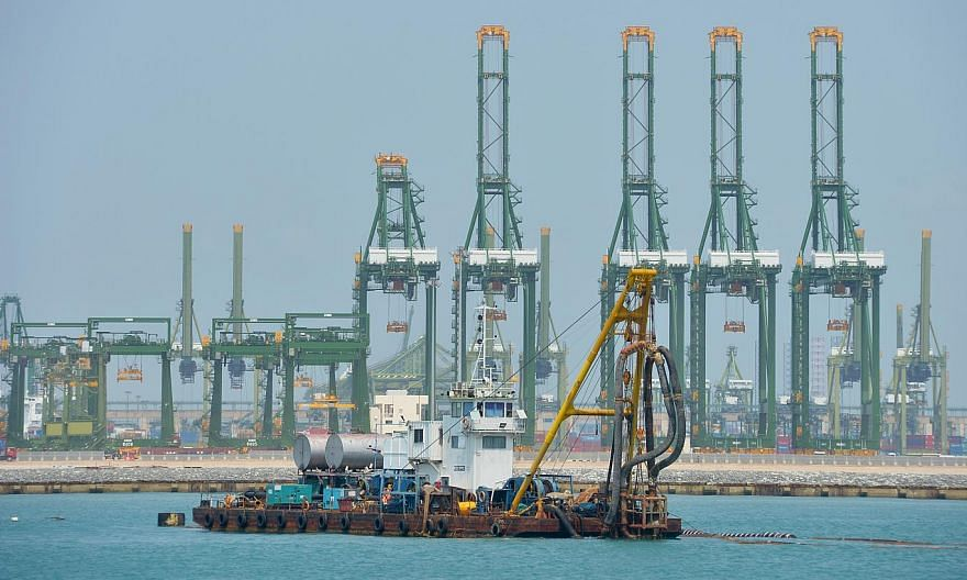 Future maritime trade routes such as Artic shipping lanes could challenge Singapore's position as a global shipping hub, but boosting efficiency and capacity will help the Republic's port stay competitive and relevant.-- PHOTO: ST FILE