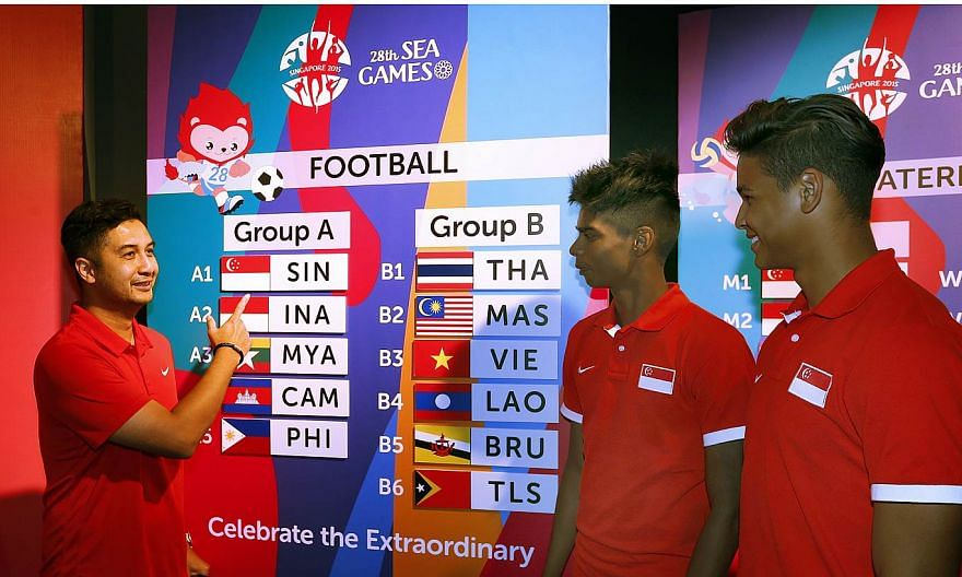 (From left) National Under-23 coach Aide Iskandar with players Iqbal Hussain and Irfan Fandi examining the draw conducted on April 15, 2015 for the June SEA Games.Aide has issued a warning to his charges, reminding them not to underestimate the