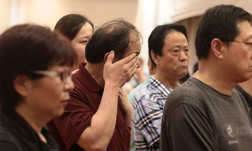 """Relatives of passengers on board the Dongfangzhixing or """"Eastern Star"""" which sank en route from Nanjing to Chongqing, react as they wait for information at a hotel in Nanjing, Jiangsu province on June 2, 2015. Family members of some of the passengers"""