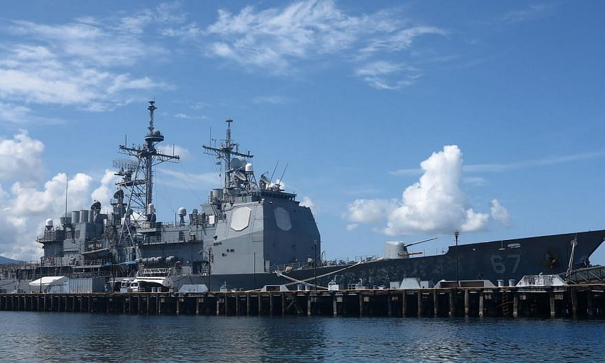 A US warship anchored last Thursday at Subic Bay in the Philippines as part of a military patrol in the South China Sea. The US-China status quo may not be sustainable and could transition to a crisis. A compromise could avoid such a scenario and sho