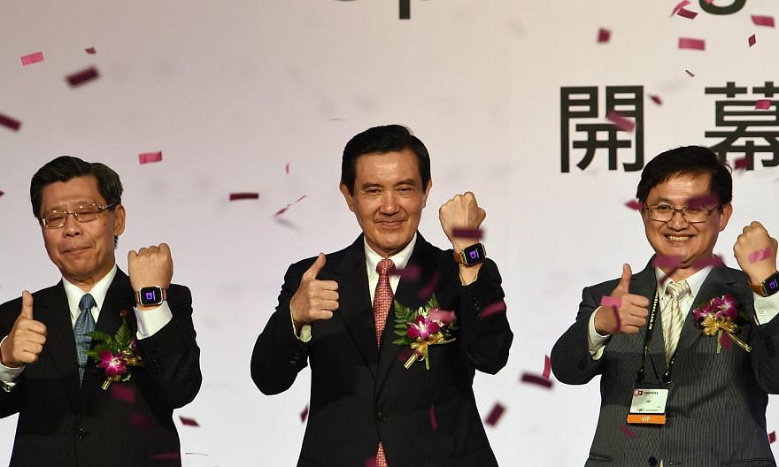 Taiwanese President Ma Ying-jeou (centre) with local officials during the opening of the Computex trade show in Taipei on June 2, 2015. Mr Ma warned on Tuesday of damage to Taiwan's economy if the legislature does not pass controversial trade deals w