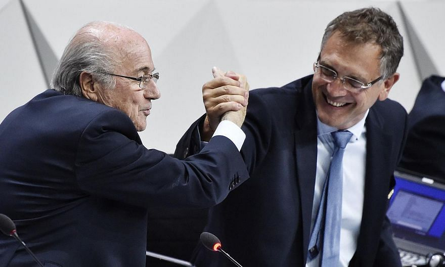 This May 29, 2015 file photograph shows Fifa President Sepp Blatter (left) shaking hands with Fifa general secretary Jerome Valcke (right) during the 65th Fifa Congress in Zurich, Switzerland. -- PHOTO: AFP