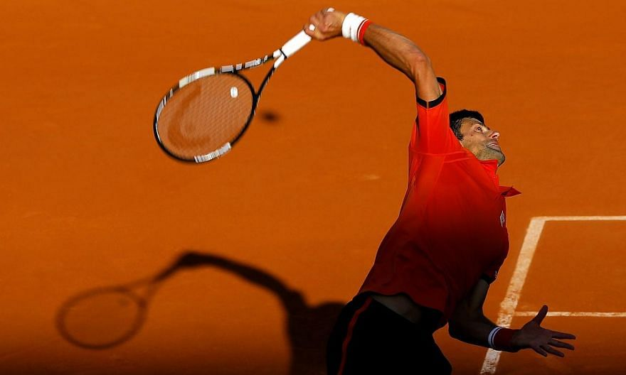 Novak Djokovic of Serbia in action against Richard Gasquet of France during their fourth round match for the French Open tennis tournament at Roland Garros in Paris on Monday (June 1). -- PHOTO: EPA