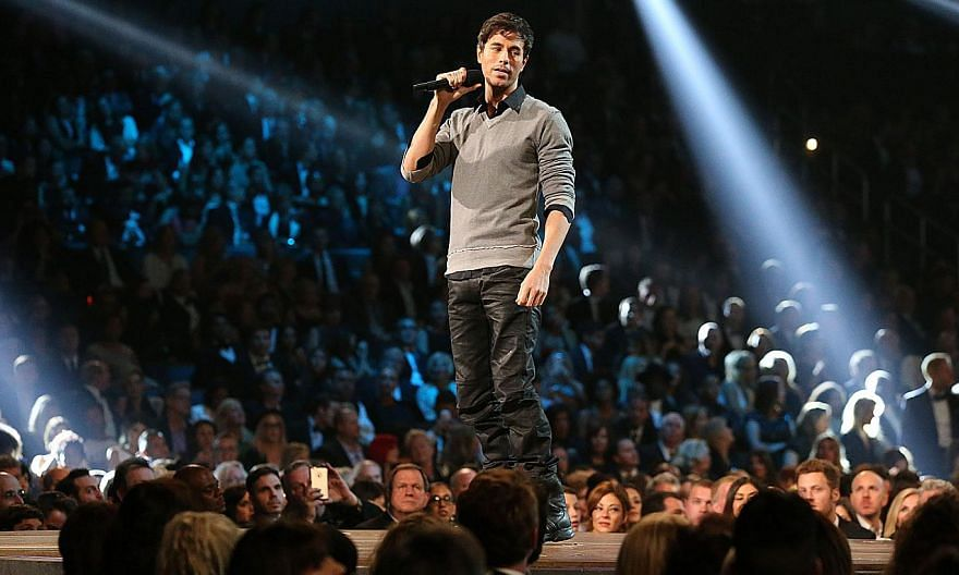 Enrique Iglesias performing at the 57th Annual Grammy at the Staples Center in Los Angeles on Feb 8, 2015. Iglesias will need weeks to recover after injuries suffered from a drone during a concert turned out to be worse than feared. -- PHOTO: AFP&nbs
