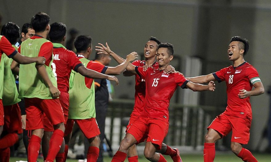 Singapore's under-23 defender Sheikh Abdul Hadi Sh Othman (No.15) celebrating with his teammates after scoring the goal against the Philippines at the 28th Sea Games held at the Jalan Besar Stadium on June 1,2015.Singapore's coach Aide Is