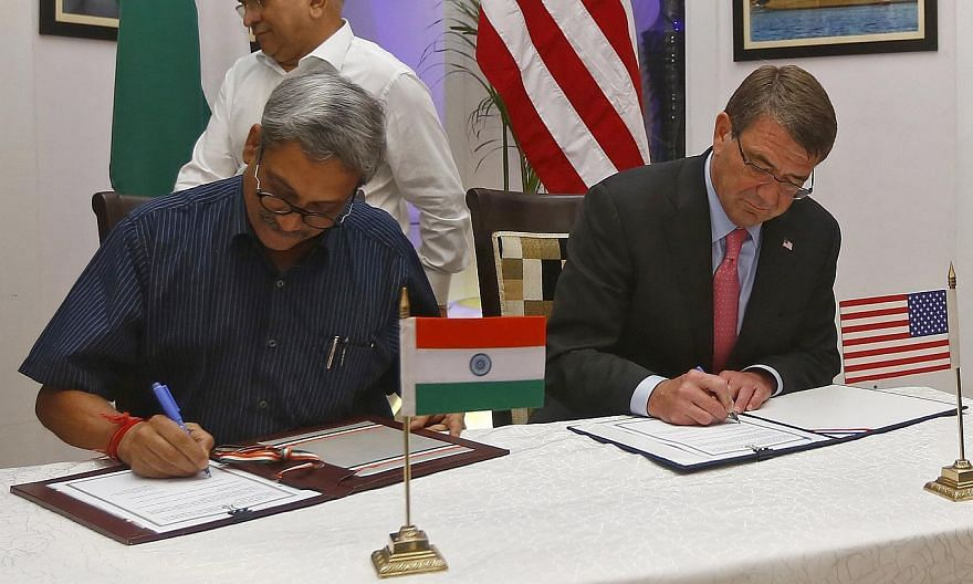 US Defence Secretary Ashton Carter (right) and India's Defence Minister Manohar Parrikar at the signing of agreements ceremony in New Delhi, India, on June 3, 2015. -- PHOTO: REUTERS
