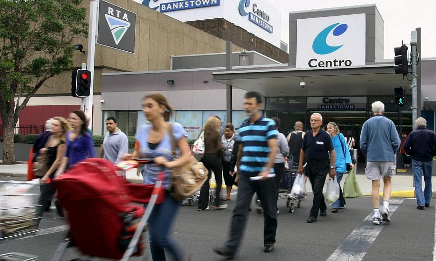 Shoppers outside a Sydney shopping centre in 2011. Australian retail sales went flat in April in a blow to hopes for a sustained pick up in consumer demand while the country's trade deficit blew out to a record as exports sagged, a double whammy that