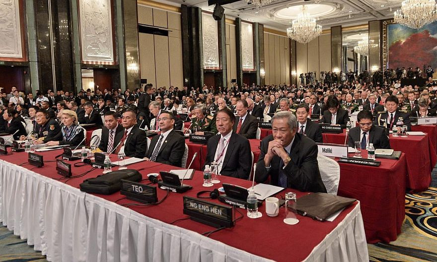 Defence ministers and delegates listening to US Secretary of Defence Ashton Carter at the Shangri-La Dialogue in Singapore on May 30, 2015. -- PHOTO: AFP
