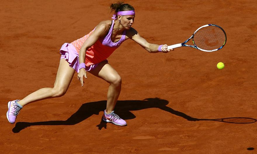 Lucie Safarova in action against Ana Ivanovic during the semi-final match at Roland Garros in Paris on June 4, 2015. -- PHOTO: EPA