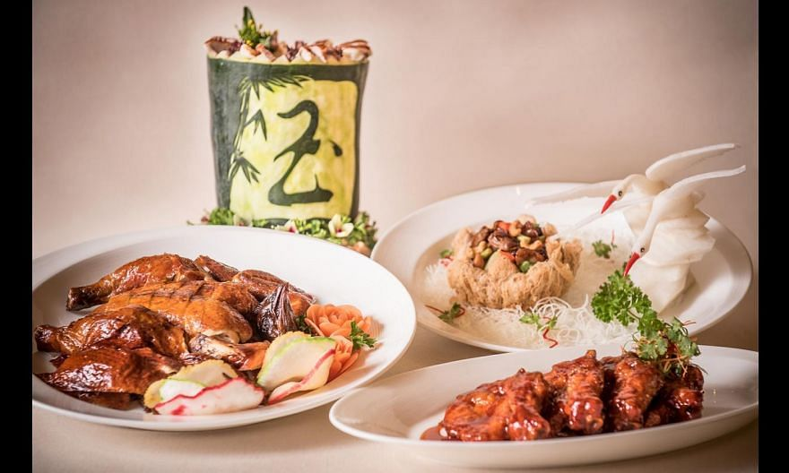 The new menu includes (clockwise from left) roast chicken, double-boiled winter melon soup, Kung Pao Chicken with Cashew Nuts served in Buddha's Bowl and Pork King Ribs.