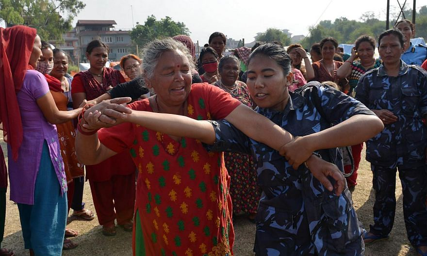 Nepal is teaching self-defence to quake-affected women and children following a string of attacks in temporary camps housing survivors, police said on Friday, June 5, 2015. -- PHOTO: AFP