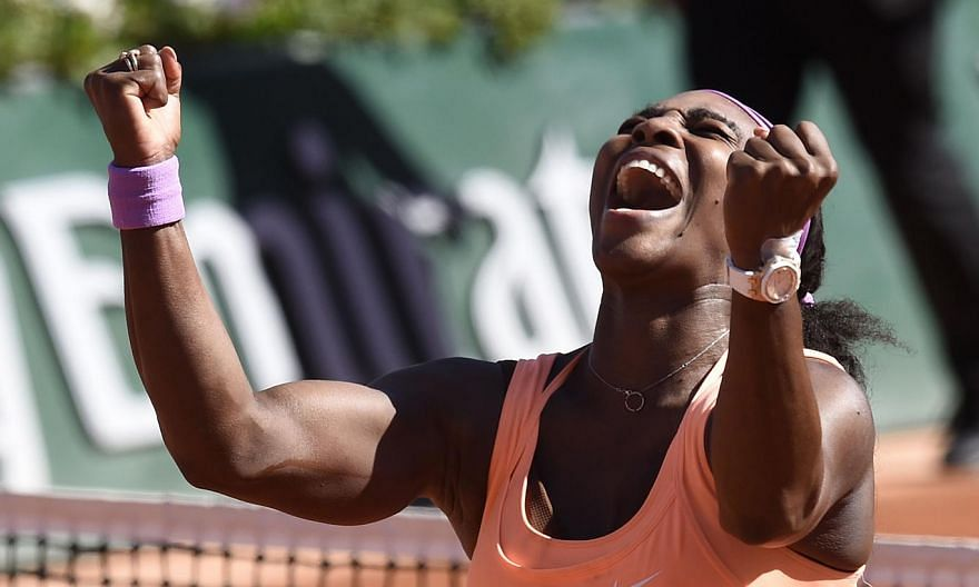 Serena Williams of the US celebrates after defeating Lucie Safarova of the Czech Republic during their women's final match of the Roland Garros French Tennis Open in Paris on June 6, 2015. -- PHOTO: AFP
