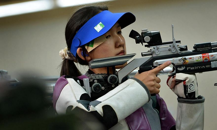 Jasmine Ser (above), Tessa Neo and Martina Lindsay Veloso beat rivals Malaysia with a convincing total score of 1233.9 points in the event. -- PHOTO: ST FILE