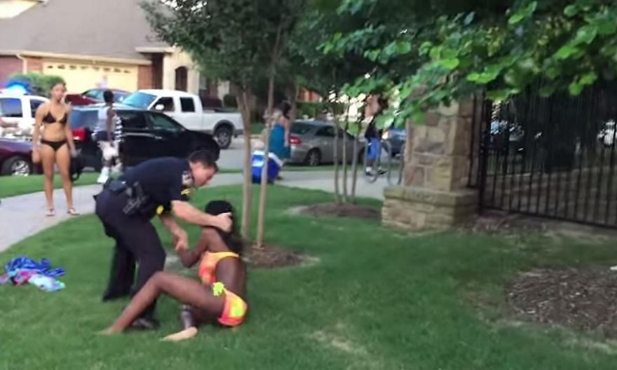 Police officer Eric Casebolt seen throwing a bikini-clad black teenage girl to the ground at a pool party disturbance in Dallas, Texas. -- PHOTO: SCREENGRAB FROM YOUTUBE